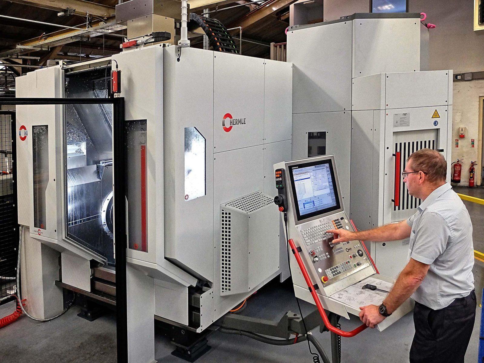 technician operating Hermle machine