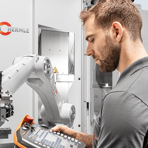 technician operating automated robotic arm